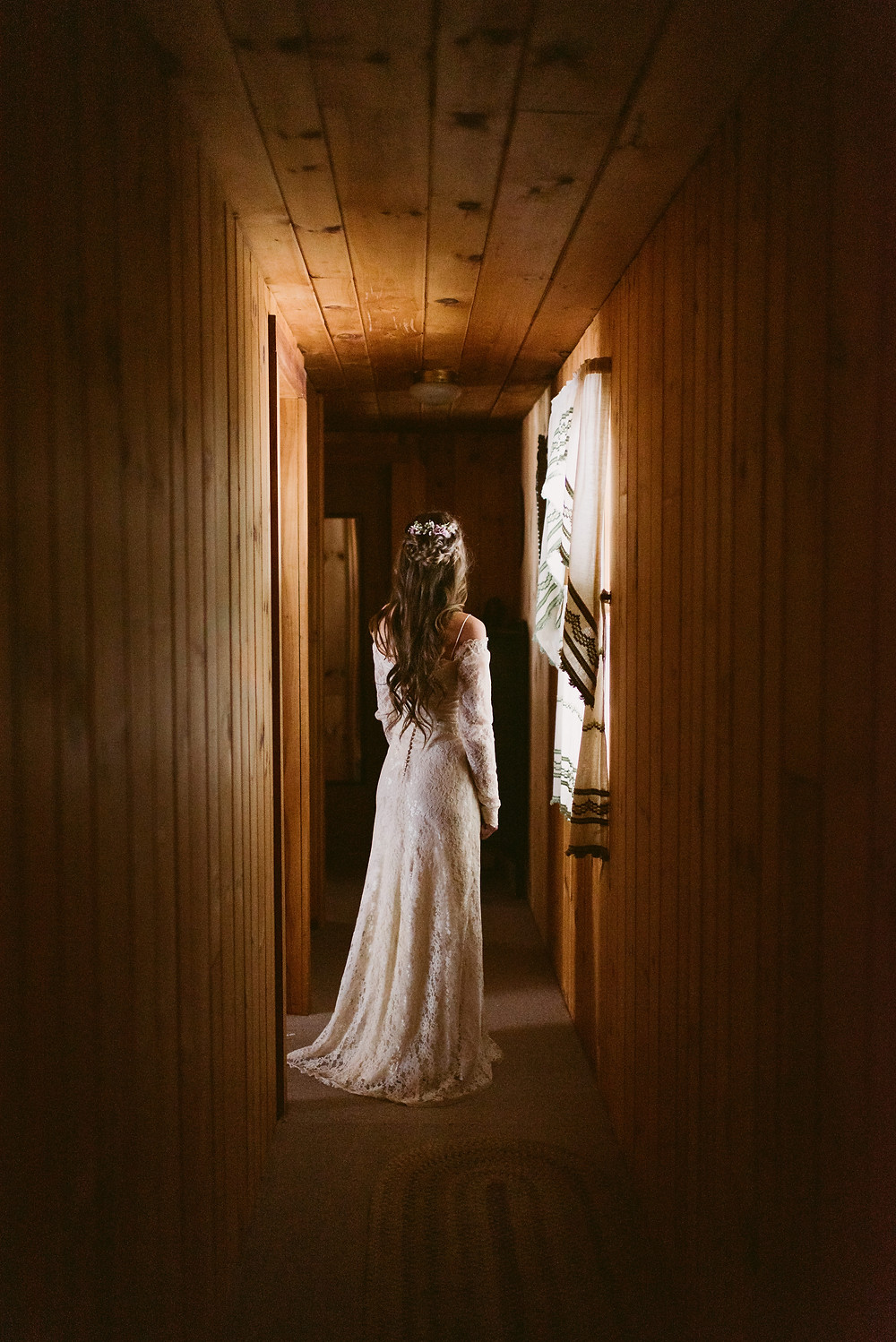 Bridal portraits in the window light of her family's cabin in upstate New York
