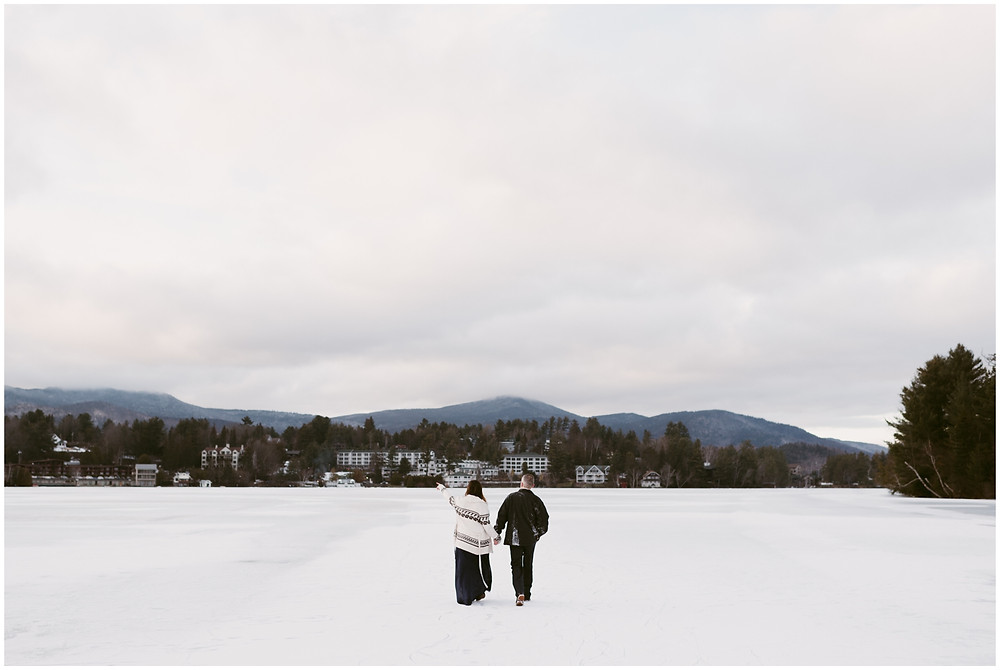 A winter Lake Placid engagement session on Mirror Lake by Mountainaire Gatherings