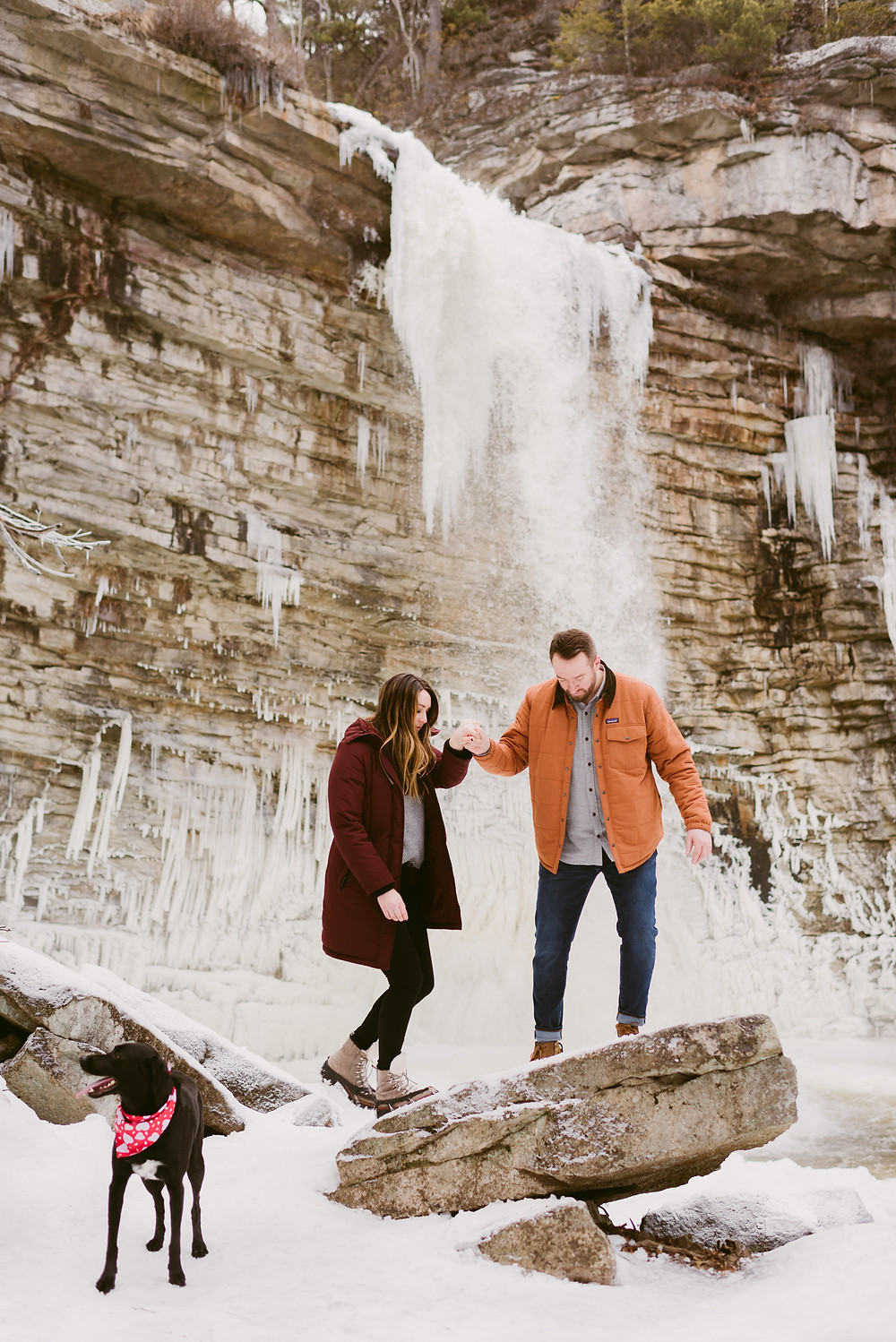 Couple takes their engagement photos in front of Awosting Falls in Minnewaska State Park