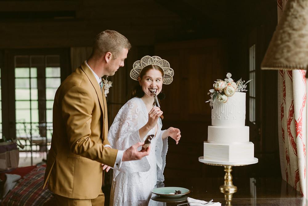 Bride playfully licks knife after cutting her wedding cake