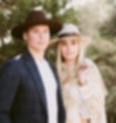 Young stylish couple wearin cowboy hats at their engagement session in Austin, TX
