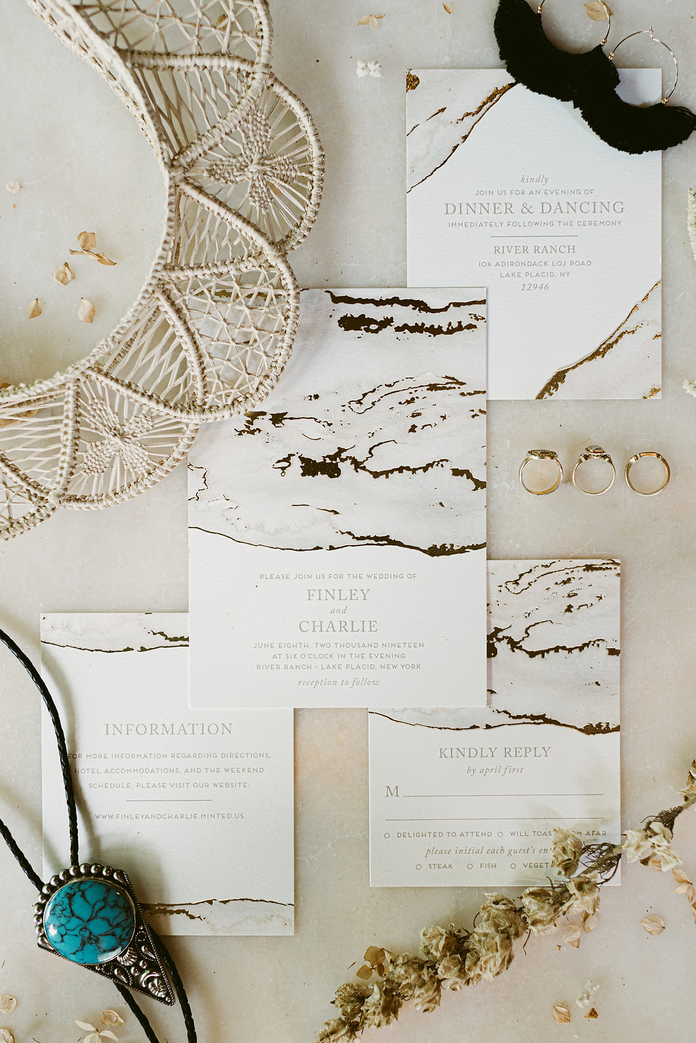 Neutral-toned wedding invitation and accessories at Lake Placid bohemian wedding