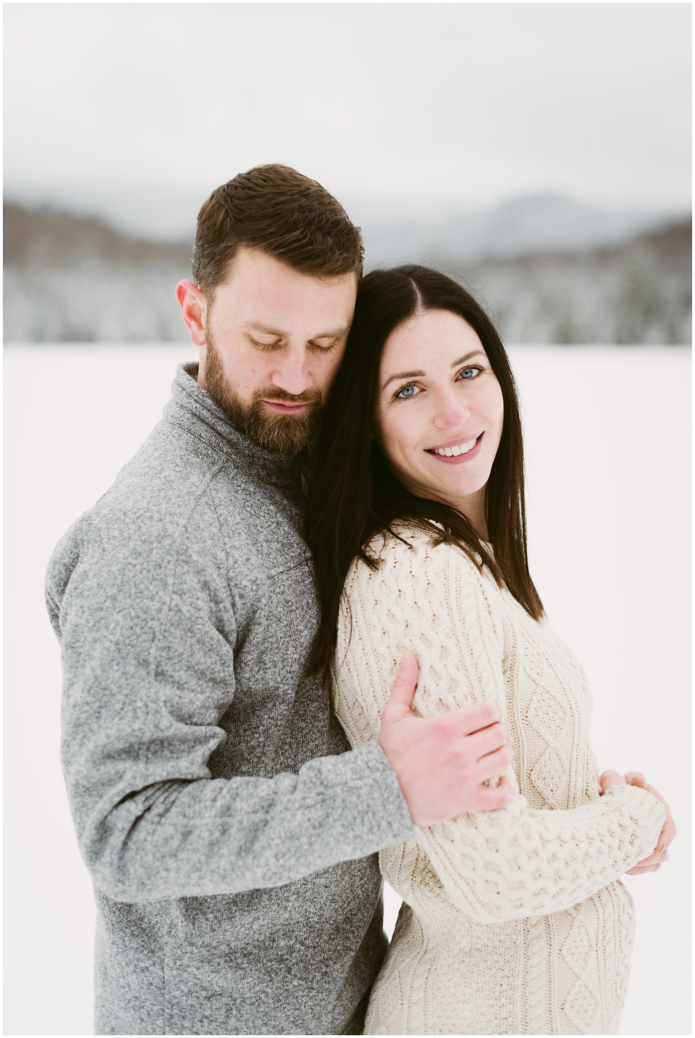 An Adirondack engagement session in the snow at the Adirondack Mountain Club by Mountainaire Gatherings