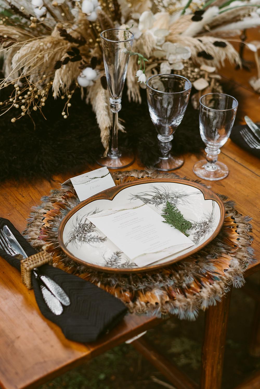 Darkly elegant tablescape for bohemian Lake Placid wedding