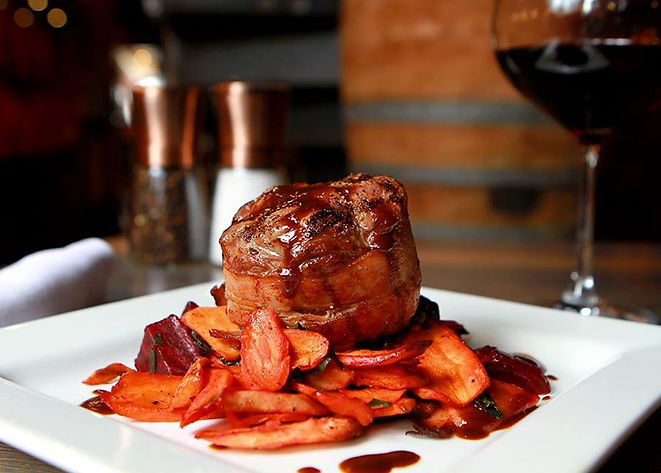 Bacon Wrapped Petite Filet with root veg