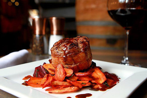 Bacon Wrapped Petite Filet with root vegetables and garlic chard
