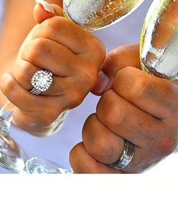 Custom made 14k white gold diamond halo engagement ring and matching wedding band