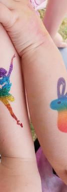 glitter & airbrush rainbow tattoo by kando entertainment
