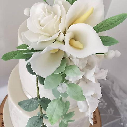 Wedding cake with icing flowers.jpg