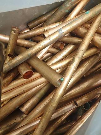 assorted scrap metal piping
