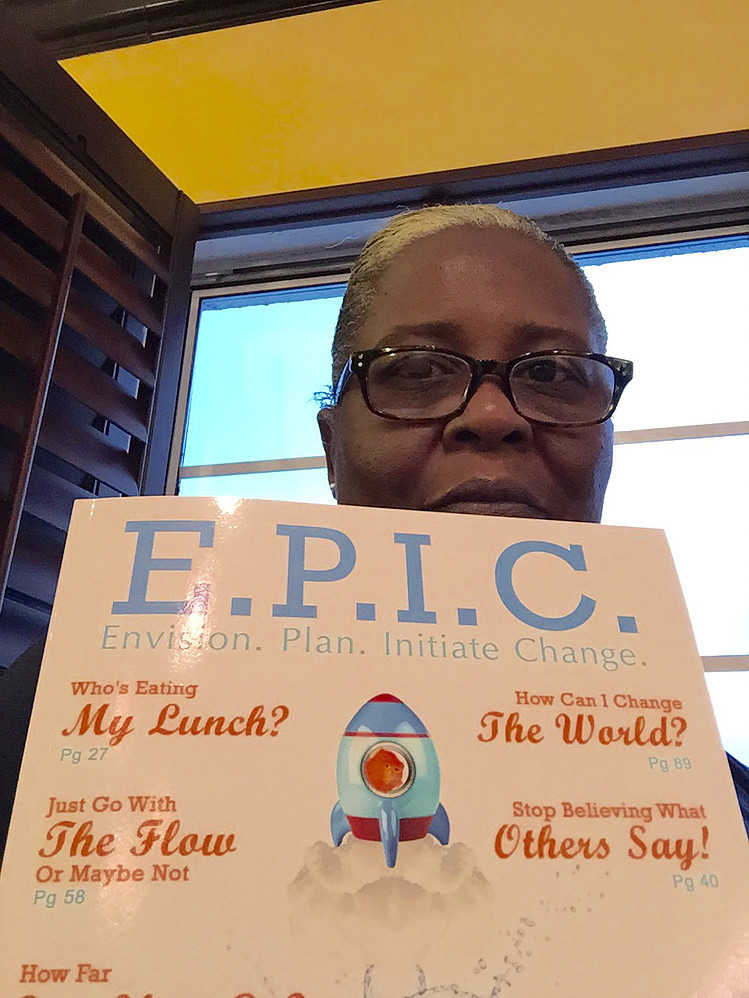 Sheila with the E.P.I.C. Guidebook