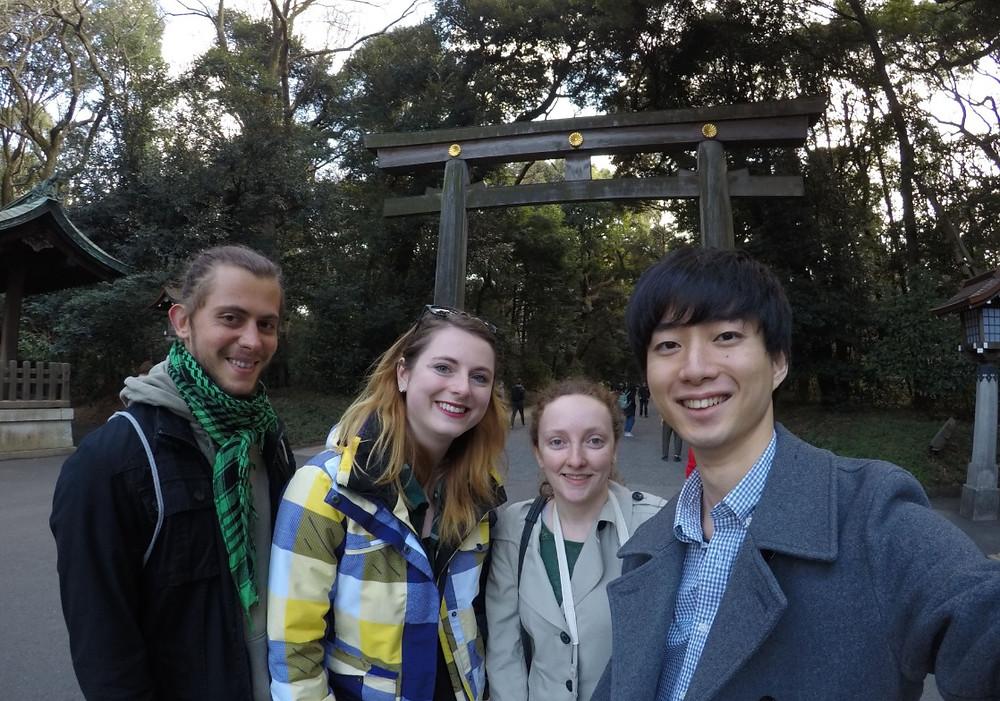 friends in front of meiji shrine tokyo