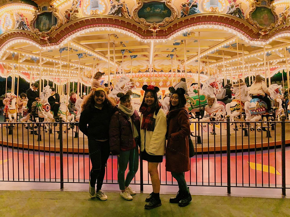 Helin with other club members at Tokyo Disneyland