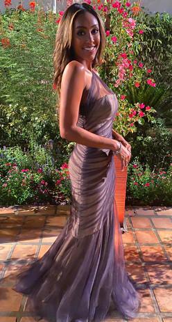 Tayshia Adams Wearing our Amanda Gown