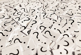 Cut up paper with question marks on the pieces