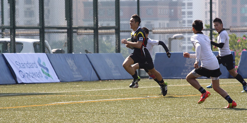 Health Wise CMC Sponsored Rugby Player Scoring a Try