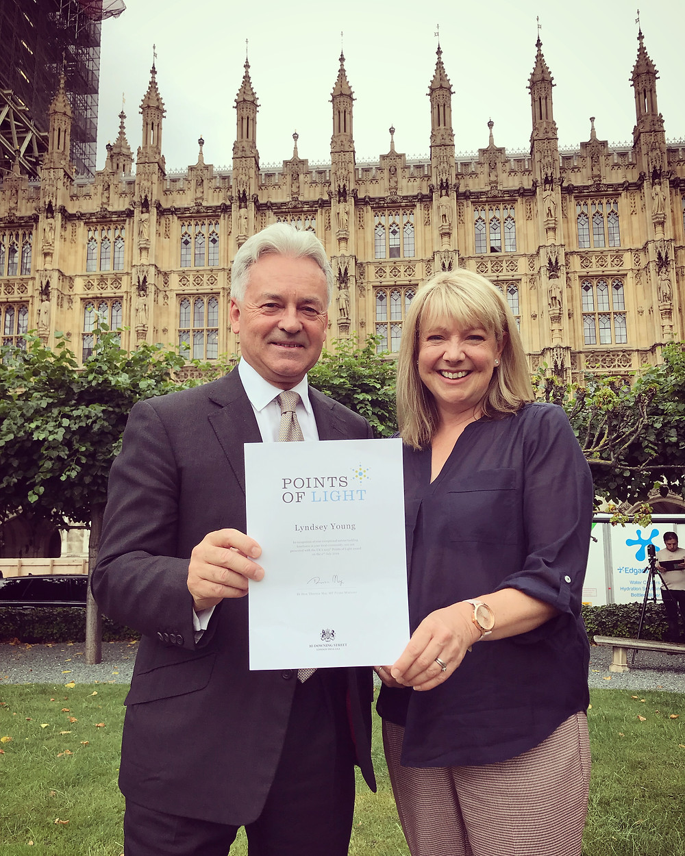 Lyndsey being presented a Points of Light award from Sir Alan Duncan MP