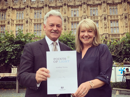 Lyndsey receives a Points of Light award from the Prime Minister
