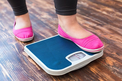 mature-woman-weight-scale.jpg