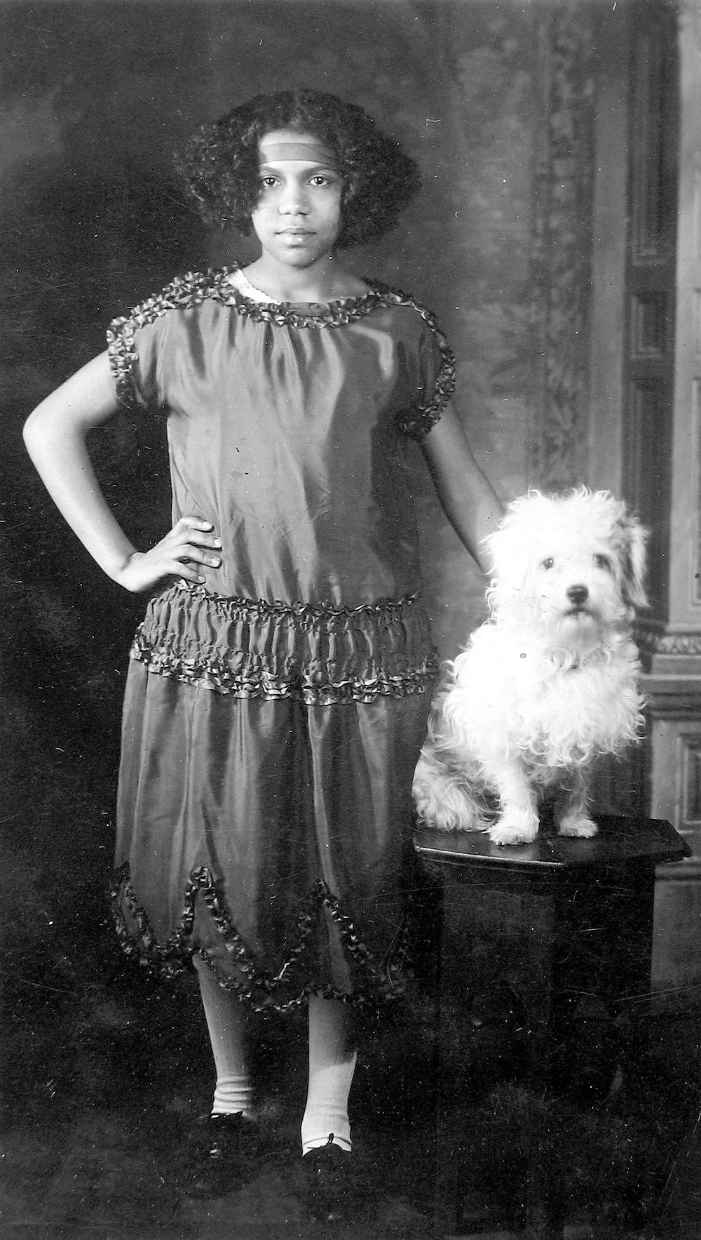 James Van Der Zee, Young Girl with Dog © Donna Mussenden Van Der Zee, Courtesy Howard Greenberg Gallery