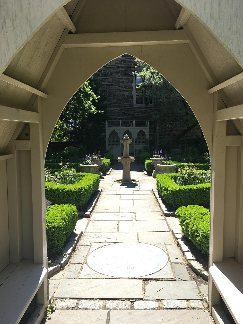 The arched entrance leading to the Biblical Garden at the Cathedral of Saint John the Divine
