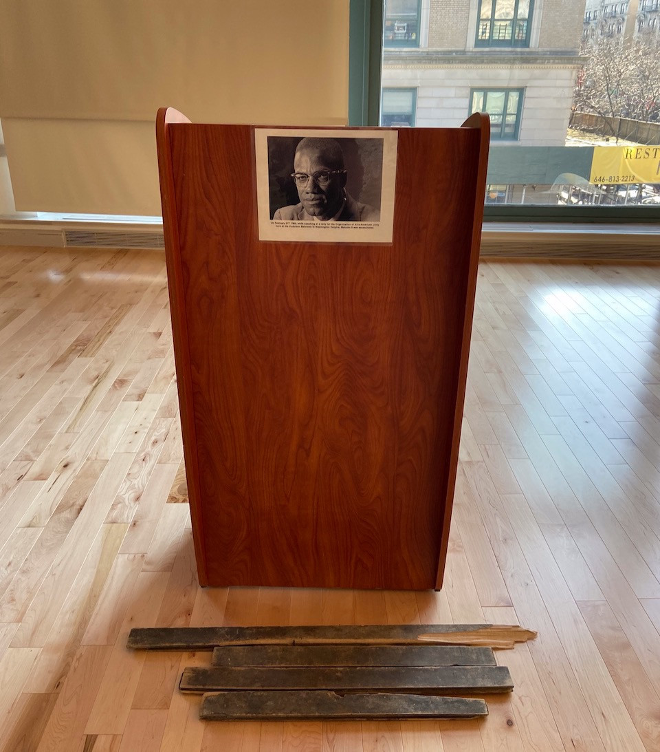 A podium marks the spot where the assassination of Malcolm X took place