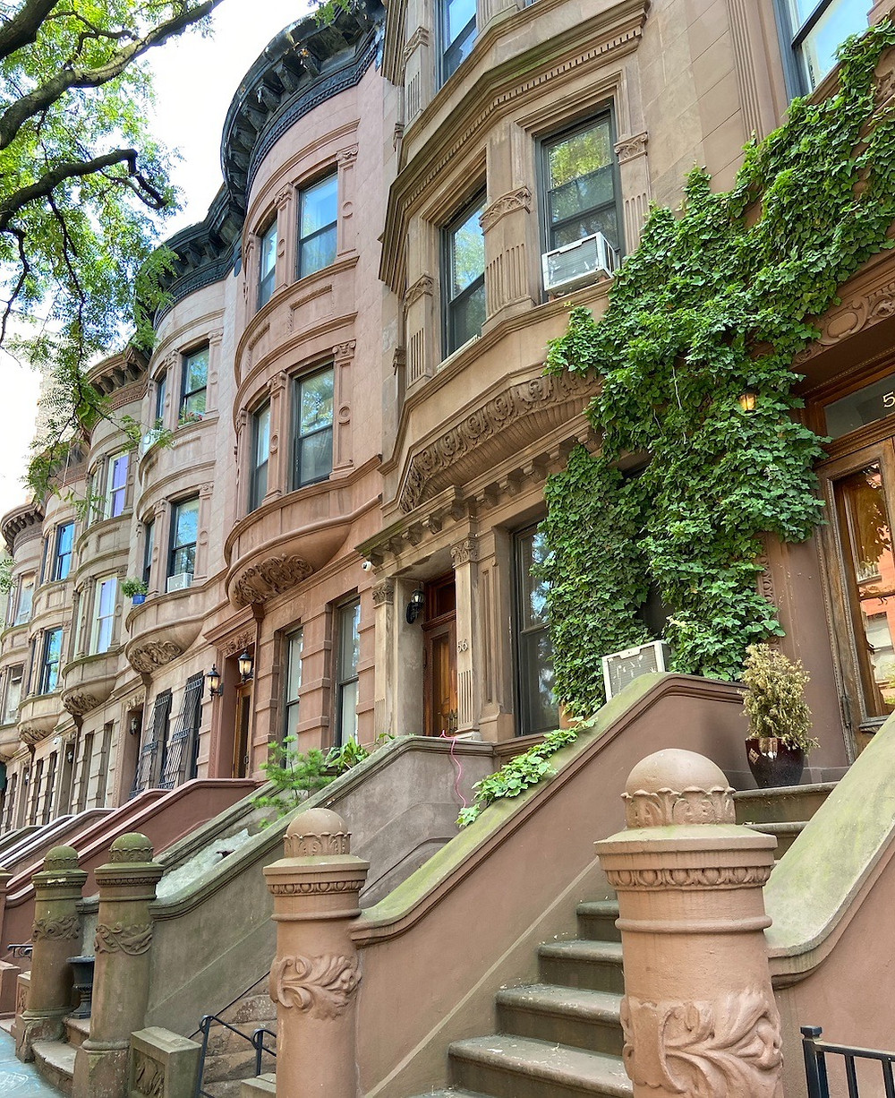 A row of Harlem brownstones on West 120th Street