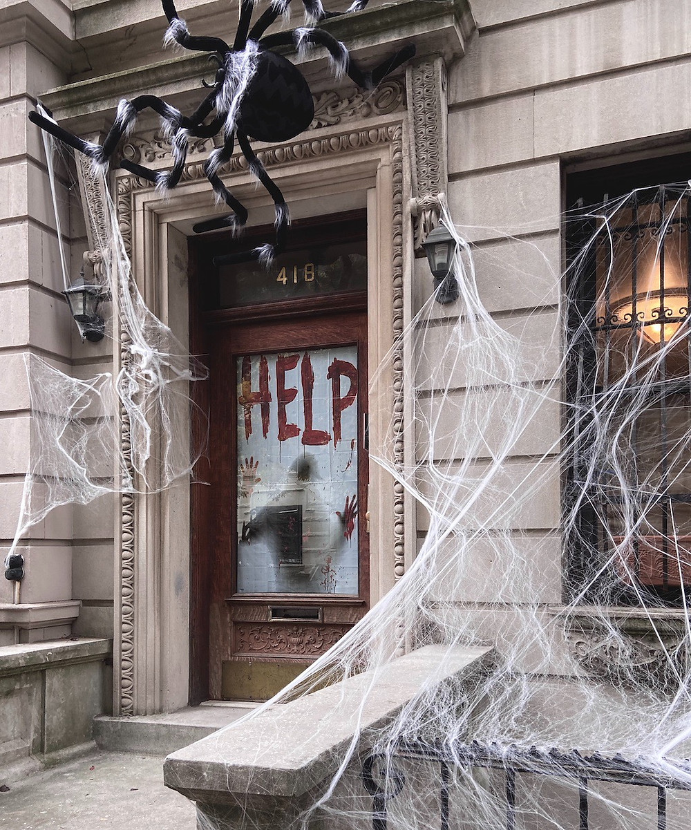 This beautiful street has the best Halloween decorations in Harlem