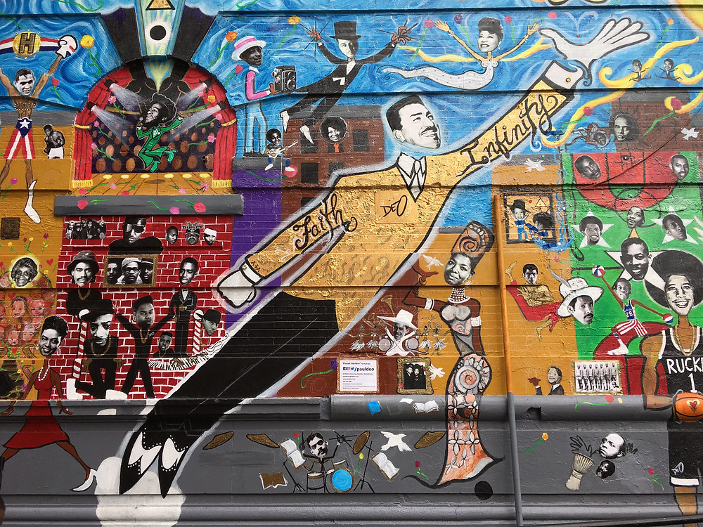 "Paul Deo's ""Planet Harlem"" mural on 126th Street"