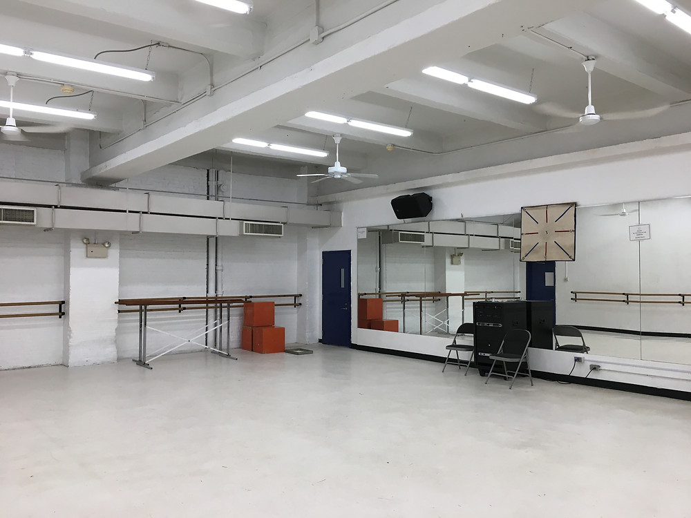 The beginner ballet class for adults is held in one of Dance Theatre of Harlem's large studios