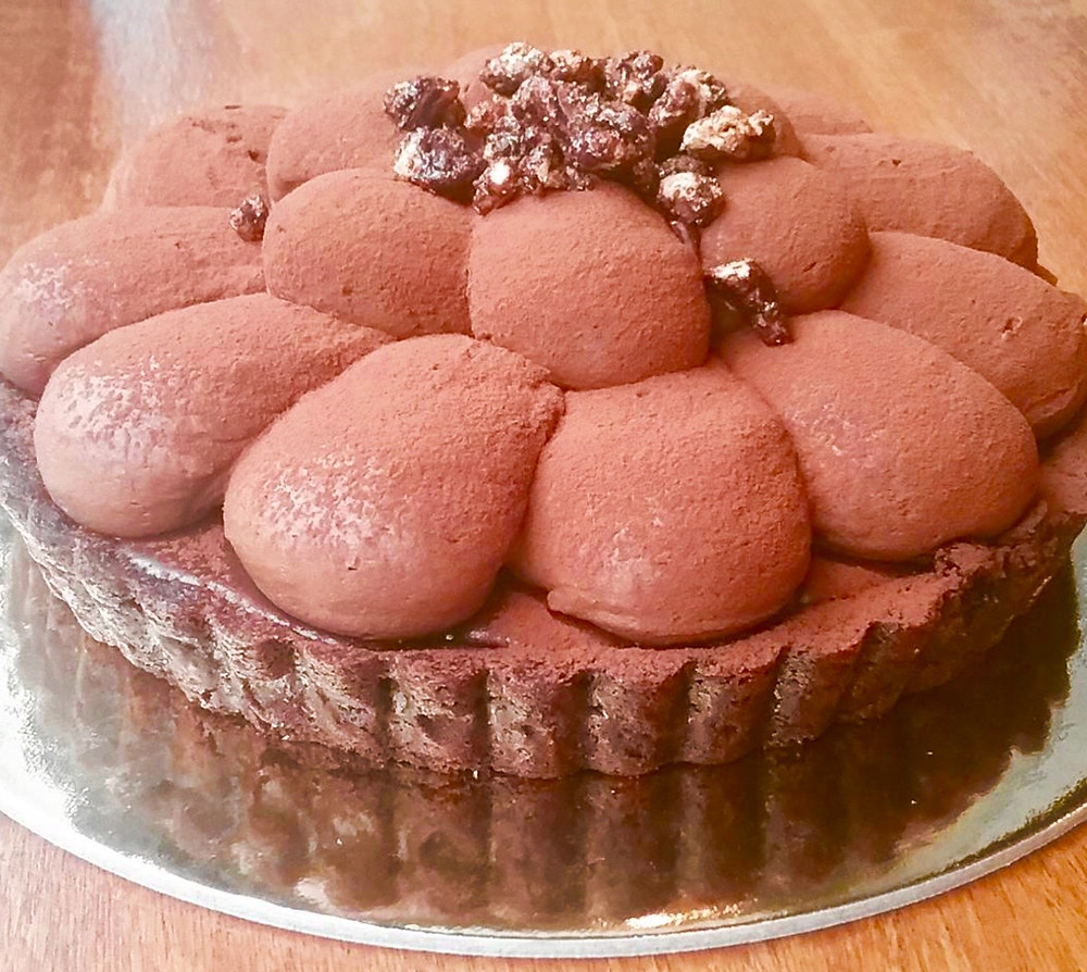 Choc NYC's chocolate cream tart, layered with caramel, chocolate ganache and spiced pecans