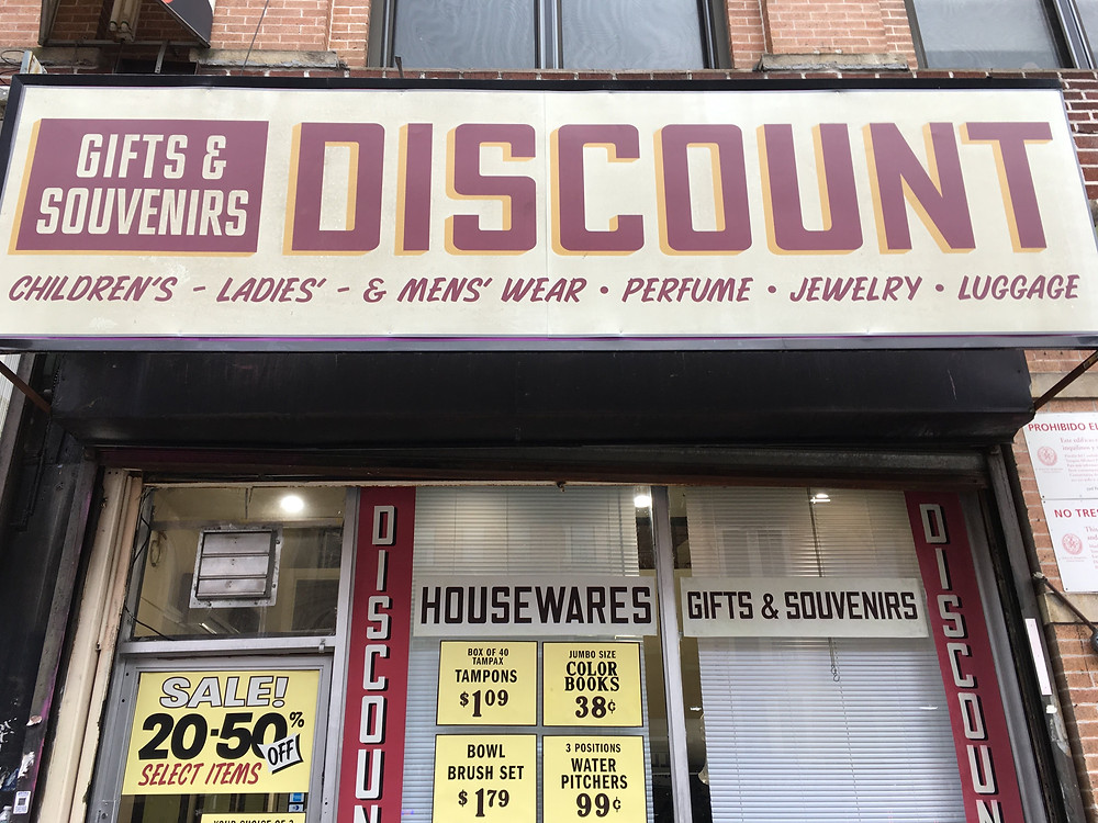 """A 1970s store sign hangs in Washington Heights for Season 2 of """"The Deuce"""""""