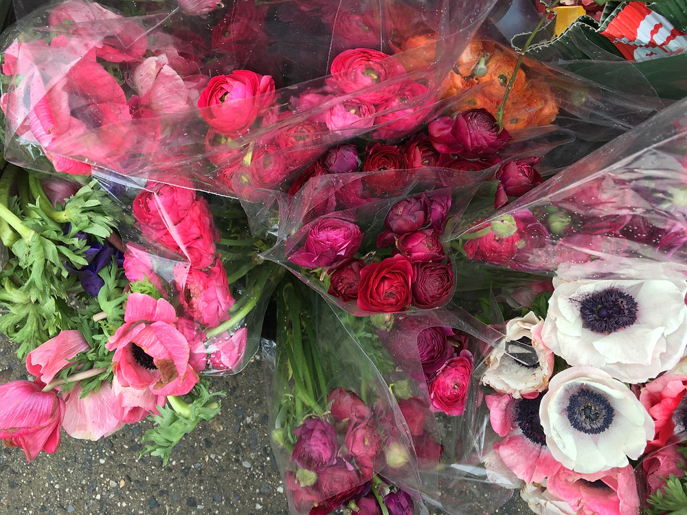 Flowers for sale outside the 137th Street subway stop