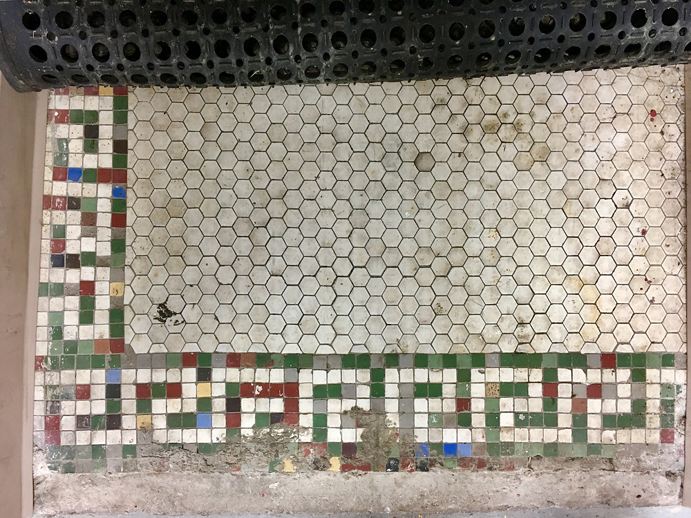 A patch of original tile at the Mt. Morris Baths