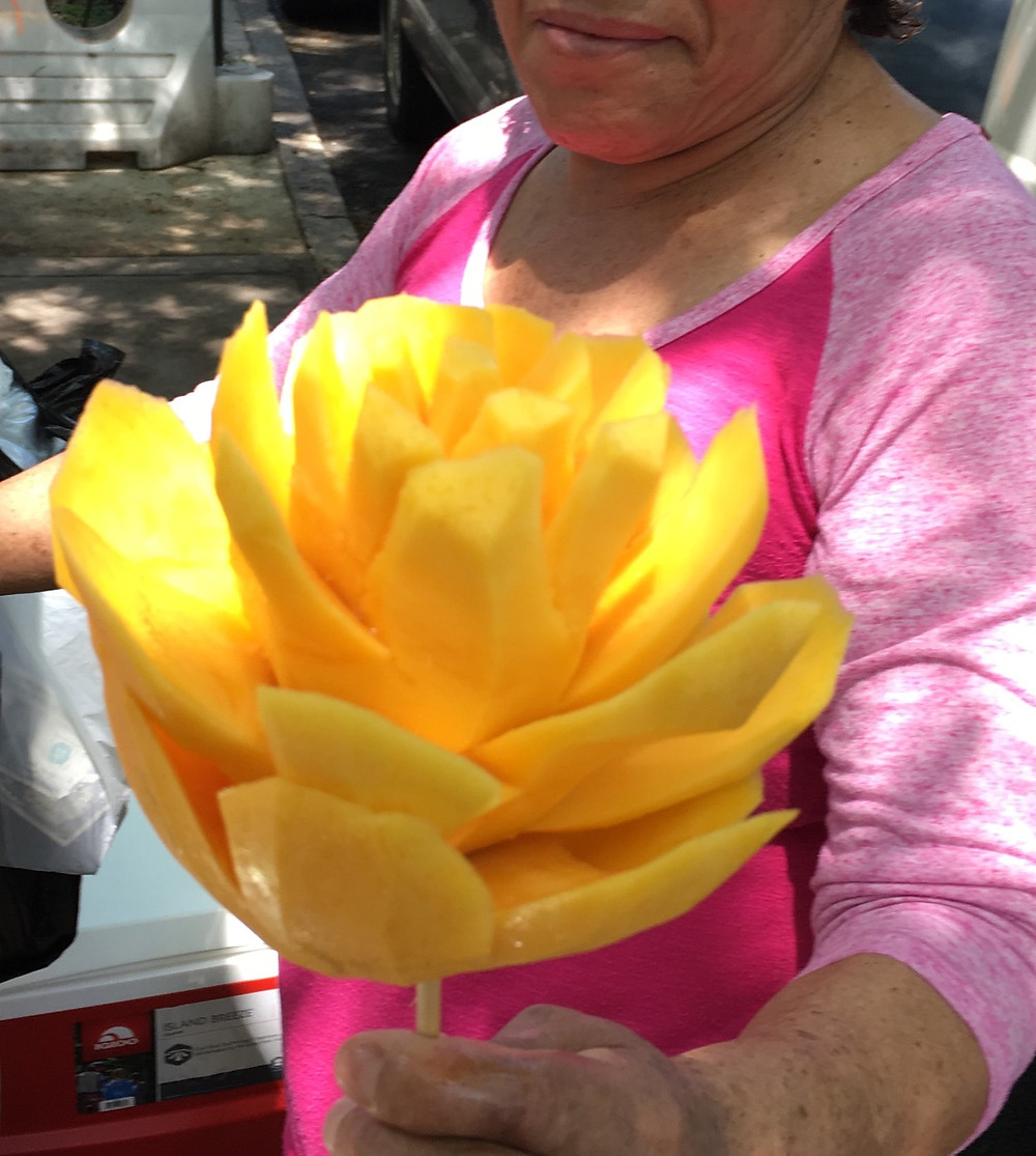 A mango flower vendor in Hamilton Heights