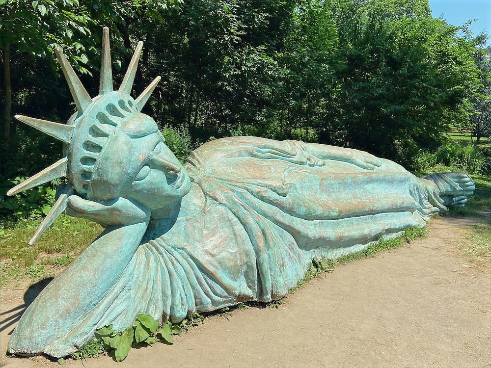 Reclining Liberty, a new 25-foot-long sculpture in Morningside Park.