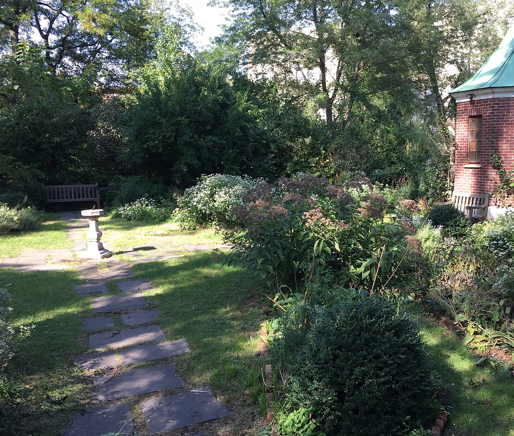 There's a sundial in the peaceful sunken garden at Roger Morris Park