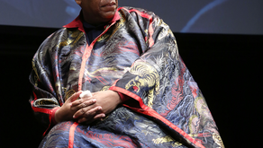 Uptown Links: André Leon Talley wears custom Dapper Dan (made with Gucci fabric), a red rose vanishe