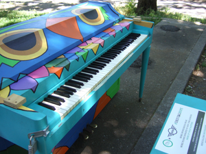 The Sing for Hope Piano designed by Whitney Roberston in Jacob Schiff Playground