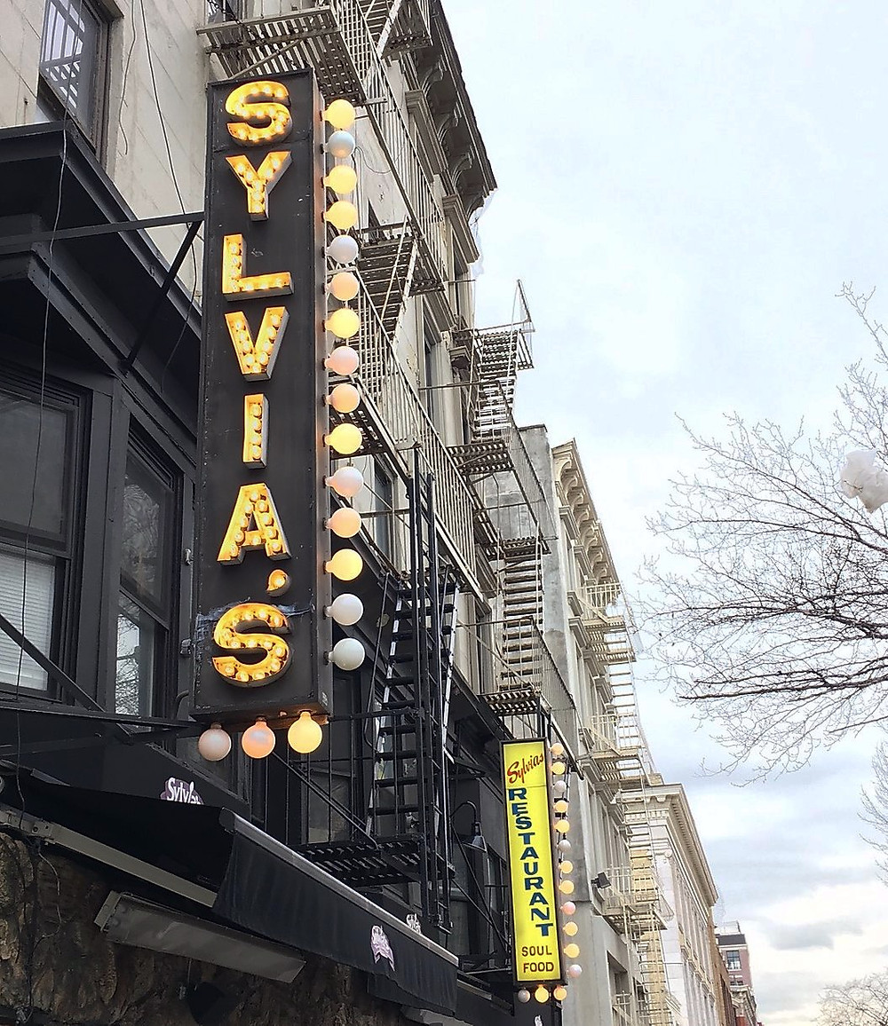 Sylvia's bulb sign is an iconic sight in Harlem