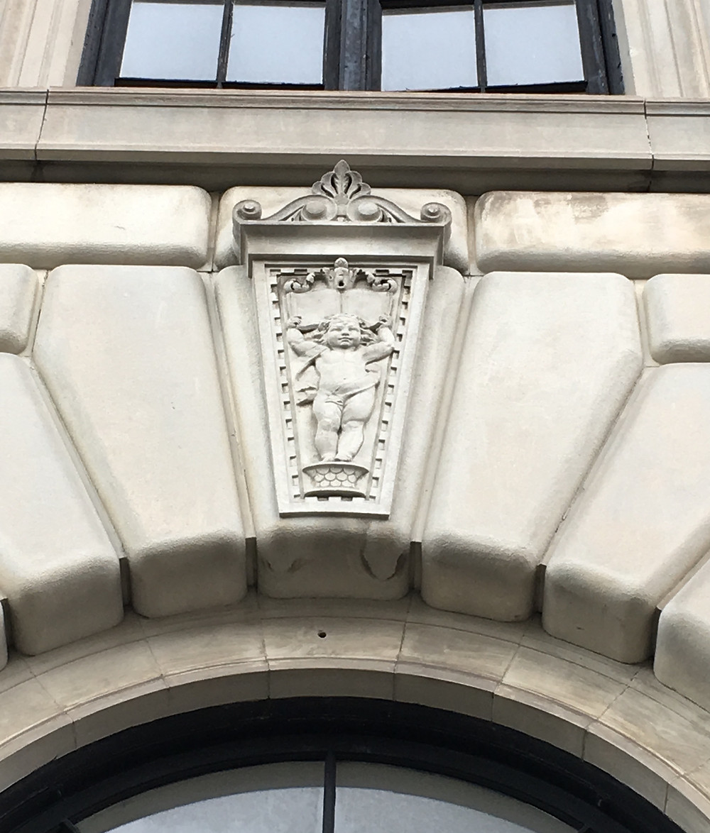 A cherub holds a clue to what's inside at NYPL's Hamilton Grange Branch