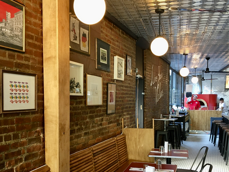A peek inside Roland's, your new Harlem spot for crispy, Roman-style pizza