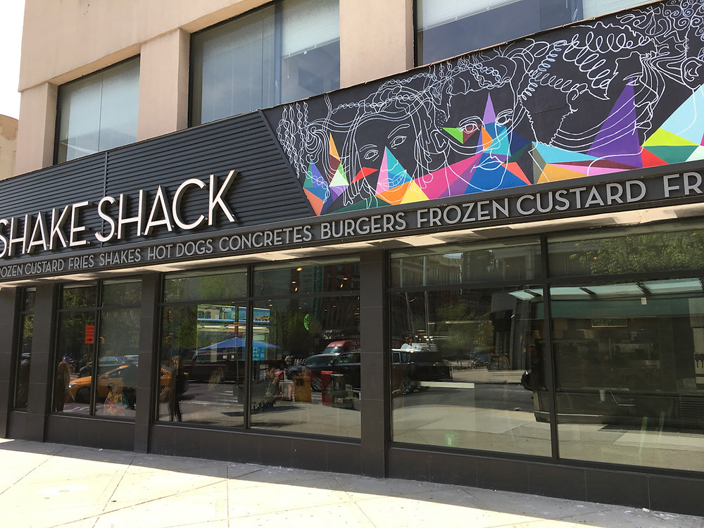 Harlem's Shake Shack has huge windows facing Fifth Avenue, the route of the New York City Marathon