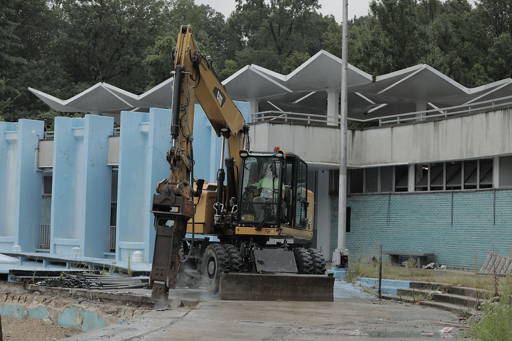 A bulldozer breaks ground at the old Lasker Rink and Pool.