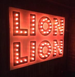 Lion Lion's bulb sign beckons