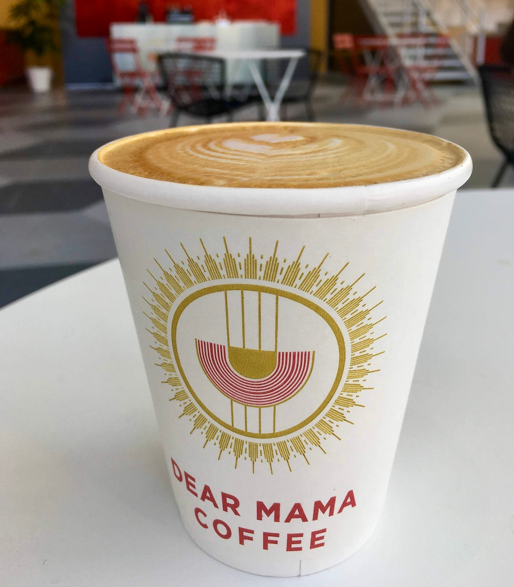 A latte to go at Dear Mama Coffee in West Harlem