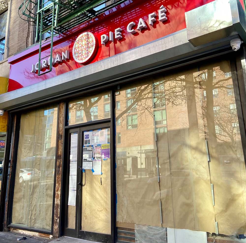 Glossy red signage is up at Jordan Pie Cafe at 18 E 116th Street in Harlem