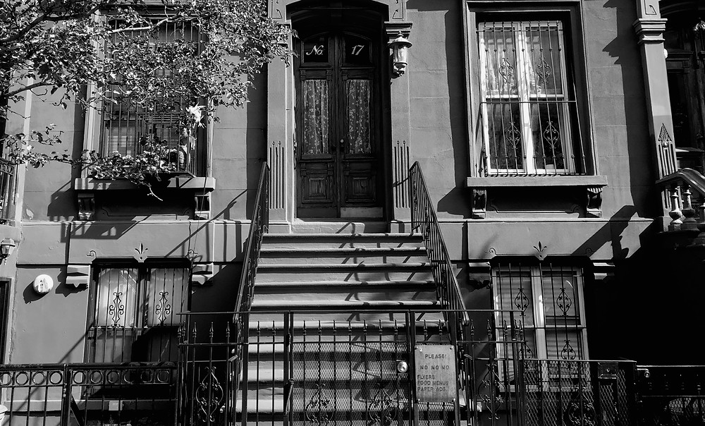 "17 E 126th Street, the address of the famous stoop featured in ""A Great Day in Harlem"" photo, as it looks today"