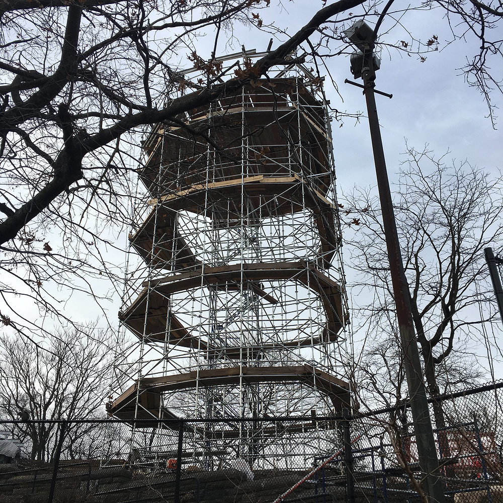 Scaffolding for the Harlem Fire Watchtower is up in Marcus Garvey Park