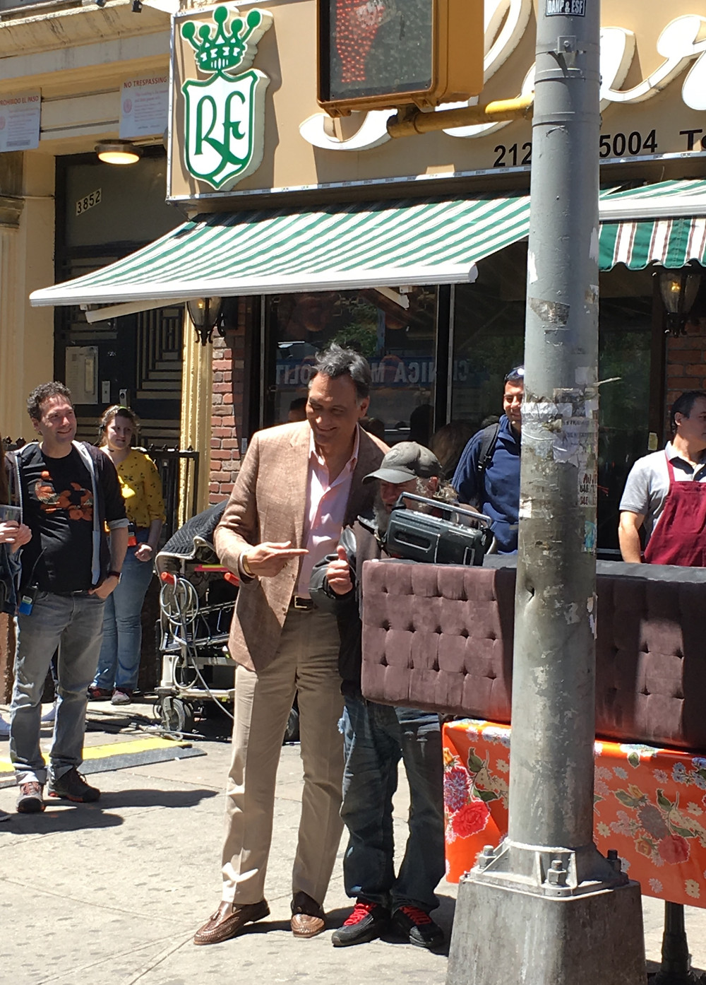 "Jimmy Smits poses for pictures during a break filming ""In the Heights"""